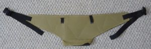 Khaki hip belt with black accents on a grey background