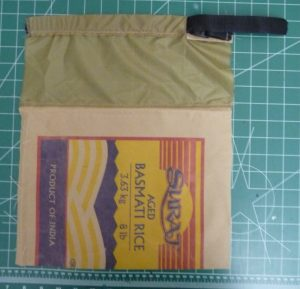 Front panel made from khaki fabric (top) and multi-colored rice-bag fabric (bottom) on a green background