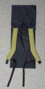 Khaki shoulder straps on a black back panel (grey bnackground)