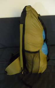 Front View of Khaki Rezac Pack with blue drybag on a grey background