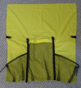 Yellow main panel with black webbing, mesh and hardware on a grey background