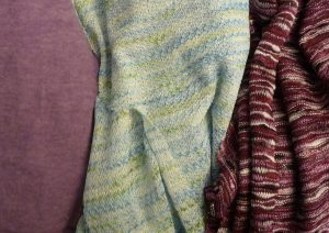 Close-up- of solid lavender, sheer blue and purple knits