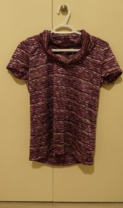 Purple On-A-Roll T-shirt on a cream background