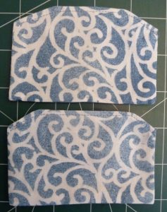 Close up of 2 blue & white side panels on a green background