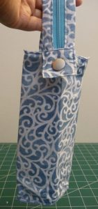 Zola Pen Case made with blue and white wirling fabric & a round silver snap