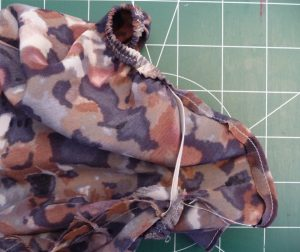 Closeup of elastic loop being sewn in to the sleeve