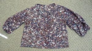 Finished Aurelis blouse in a grey background