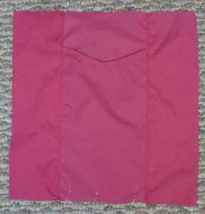 Pink square front panel on a grey background