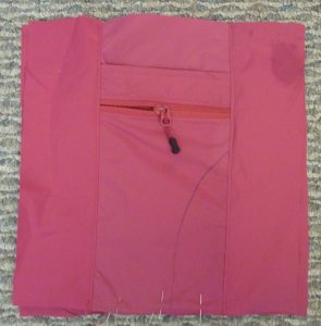 Square pink back panel on a grey background