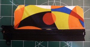 Exterior Top pieces attached to zipper