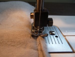 Coseup of sewing grey biastape to grey interior