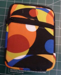 Multicolored zippered e-reader case (front view)