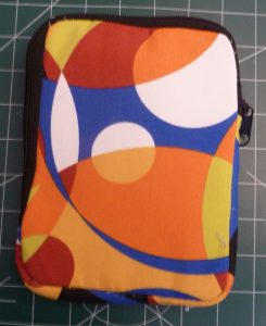 Back view of multicolored zippered e-reader case