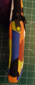 Side view of multicolored zippered e-reader ccase