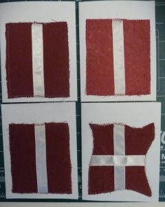 Laying out red and white fabrics on white cardstock