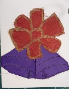 Red & gold bow above purple bells