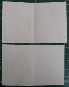 White copypaper used to hide white stitches on cardstock