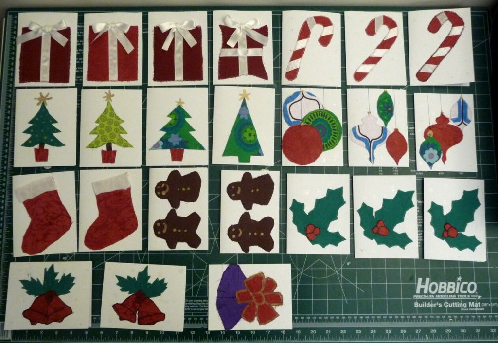 24 assorted Christmas cards on a green background