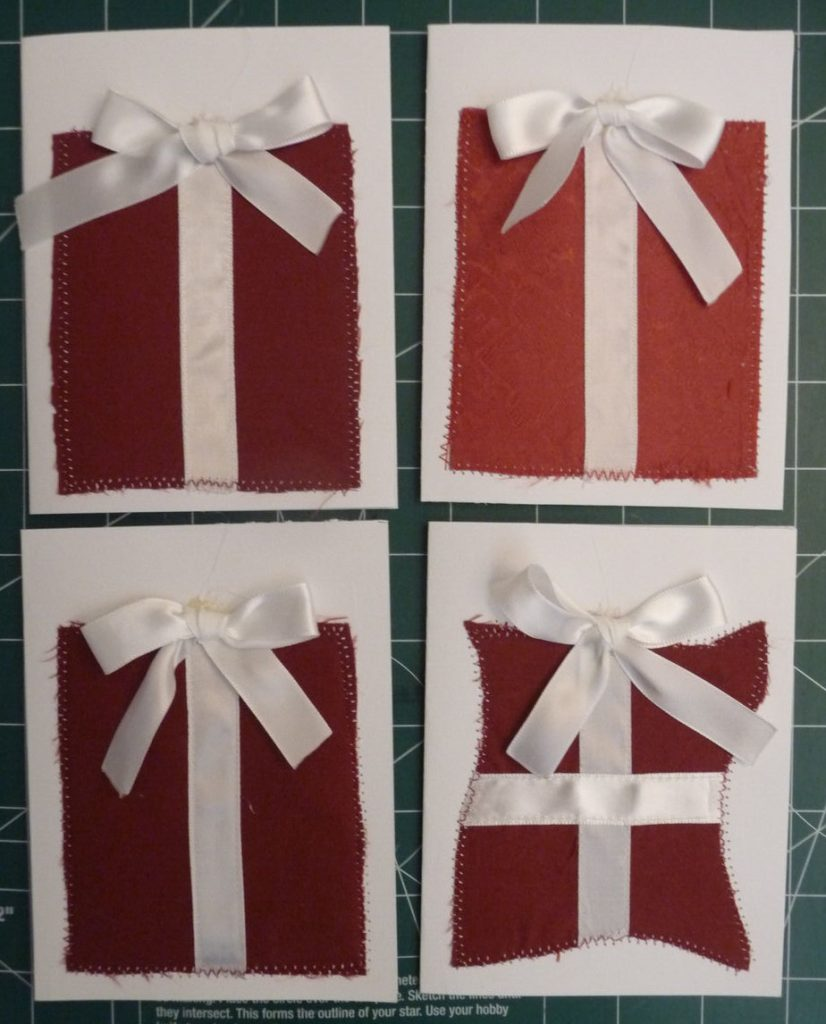 """4 red & white """"present"""" themed Christmas cards"""